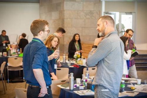 Men speaking at Boulder HEI Conference