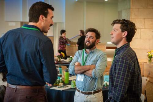 Three men talking at HEI Boulder Conference
