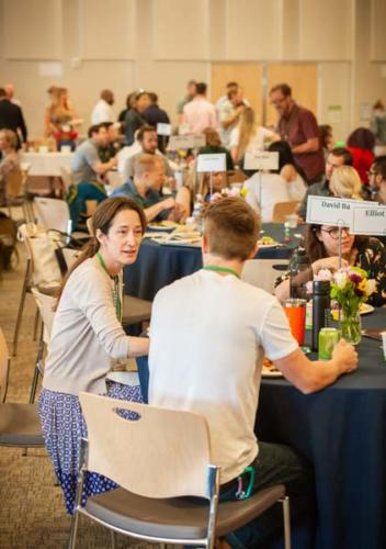 Conference attendees seated at a table