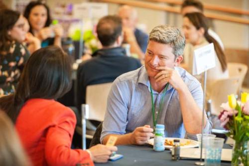 Man sitting at a table during a conference