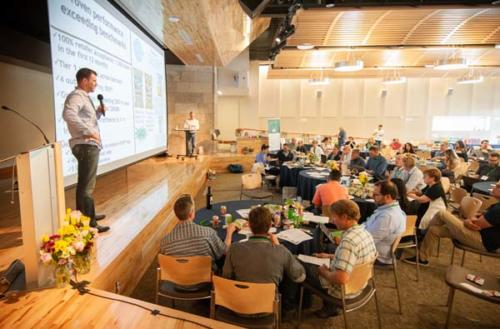 Man presenting at HEI Boulder Conference