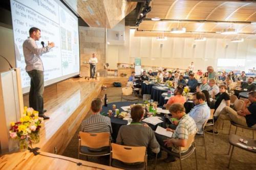 Man delivering presentation at HEI Boulder Conference
